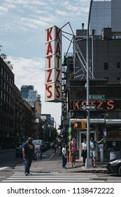 New York, USA - May 29, 2018: People walking on East Houston Street past Katz's Deli in New York, iconic kosher-style delicatessen that has been open since 1888.