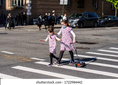 New York, USA - May 3 2020: Hasidic Jews Community and Children in Williamsburg Walking in Groups During Coronavirus COVID-19 Pandemic