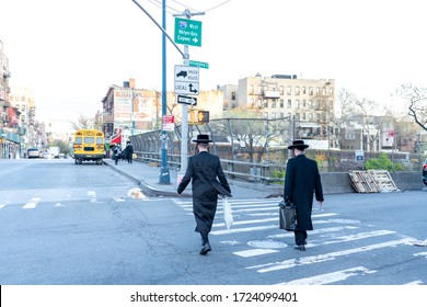 New York, USA - May 3 2020: Hasidic Jews in Williamsburg Brooklyn in the Park and on Streets in Groups and Alone with Children During Coronavirus COVID-19 Pandemic