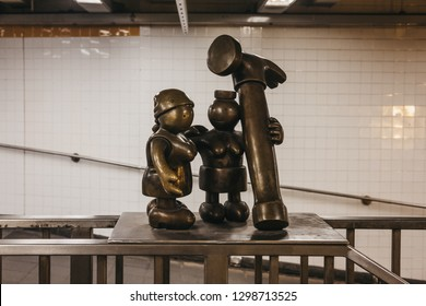 New York, USA - May 30, 2018: Life Underground bronze statues, a permanent public artwork created by American sculptor Tom Otterness for the 14th Street – 8th Avenue station of New York City Subway.