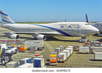 New York, USA - May 7, 2015: Airplane with luggage and cargo at the international airport