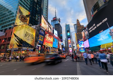 New York, USA - May 8, 2018 : Times Square crowds and traffic at night. The site is regarded as the world's most visited tourist attraction with nearly 40 million visitors annually.