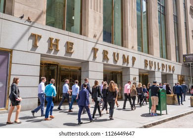 New York, USA - May 8, 2018: White collar workers outside the Trump Building at Wall Street. This building was bought by Donald Trump in 1995 and was renamed to Trump Building.