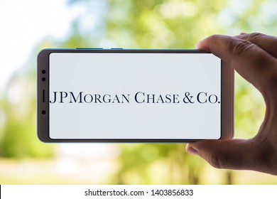 New York, USA - May 9, 2019: Logo of JPMorgan Chase displayed on the screen of the mobile device. JPMorgan Chase logo visible on display of modern smartphone on light background.