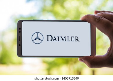 New York, USA - May 9, 2019: Logo of Daimler displayed on the screen of the mobile device. Daimler emblem visible on display of modern smartphone on light background.
