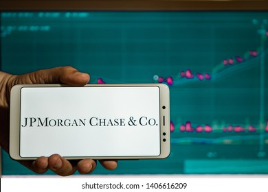New York, USA - May 9, 2019: Logo of JPMorgan Chase displayed on the screen of the mobile device. JPMorgan Chase emblem visible on display of modern smartphone on dark background.