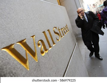 NEW YORK, USA - NOV 07, 2011. A man with mobile phone at a Wall Street, Manhattan, NYC.