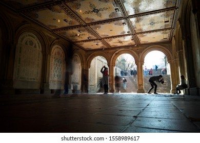 NEW YORK, USA - NOVEMBER 13, 2019: People walking on staircases and archways though the Lower passage of Bethesda Terrace in Central Park, New York, USA.