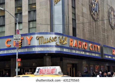 New York, USA - November 13, 2008: corner of radio city music hall, theater building, modern architecture with billboards on grey background. Entertainment and tourist destination