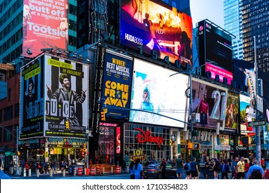 NEW YORK, USA - NOVEMBER 15, 2019: Times Square is featured with Broadway Theaters and LED signs as a symbol of New York City and the United States.