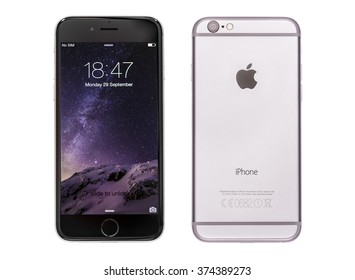 New York, USA - November 18, 2015: Front and back view of a space grey color iPhone 6 showing the home screen with iOS8. Isolated on white.