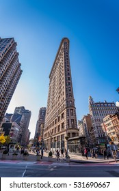 New York, USA - November 18, 2016 : Flat Iron building facade. The Flatiron Building is a triangular shaped landmark building located at Manhattan, New York City. It was completed in 1902.