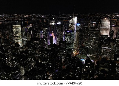New York, USA - November 20, 2010: New York City Manhattan Times Square panorama aerial view at night with office building skyscrapers skyline illuminated by Hudson River.
