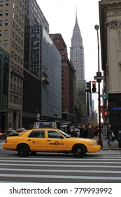 New York, USA - November 20, 2010: Taxicab under the Chrysler building. It was the world's tallest building (319 m) before it was surpassed by the Empire State Building in 1931