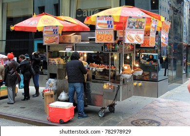 New York, USA - November 20: Food vending carts on the street in Manhattan. These mobile food carts require permits