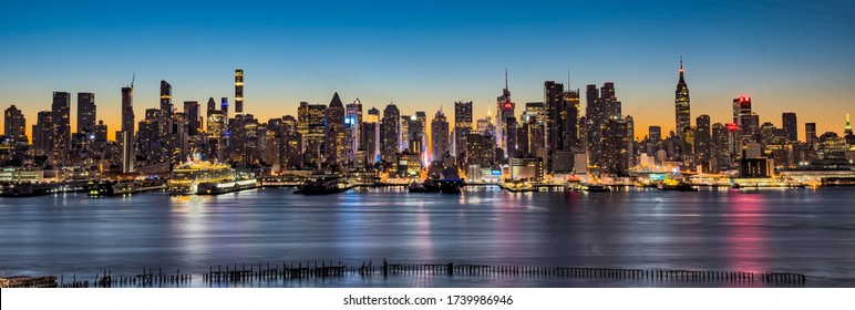 New York / USA - November 2016: Wide panorama image of skyscrapers in Manhattan, New York at dawn. New York or New York City(NYC) is the most populous city in the United States.
