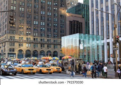 New York, USA - November 21, 2010: Apple Store cube and yellow cabs on 5th Avenue in New York City.
