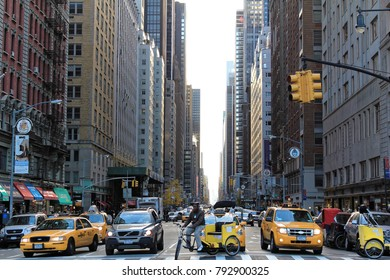 New York, USA - November 21, 2010: People ride yellow taxi cabs along 6th Avenue. There were 13,237 yellow taxi cabs registered in New York City.