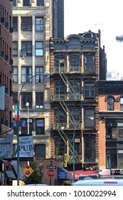 New York, USA - November 22, 2010: Old residential buildings in Broadway district. Fire escape stairs.