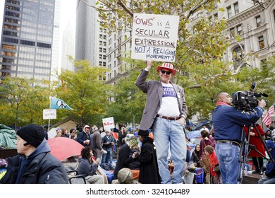 New York, New York, USA - November 3, 2011: Man holds up Occupy Wall Street sign at Zuccotti Park in Manhattan. The crowd of protestors can be seen in the background.