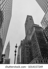 New York, USA - November 5, 2017. A street in Manhattan view with facades of skyscrapers and Chrysler Building. Black and white view look up.