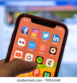 NEW YORK, USA - NOVEMBER 7, 2017: Social media app icons on modern smartphone display close-up around other iphone applications