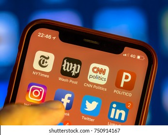 NEW YORK, USA - NOVEMBER 7, 2017: News agency app icons on new smartphone display close-up around other social media iphone applications