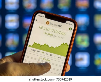 NEW YORK, USA - NOVEMBER 7, 2017: Crypto currency app with graph of value development and buy bitcoin option