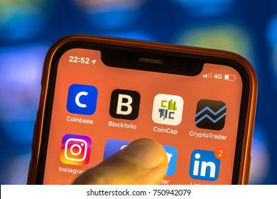 NEW YORK, USA - NOVEMBER 7, 2017: Crypto currency app icons on new smartphone display close-up around other social media iphone applications