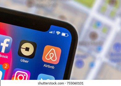 NEW YORK, USA - NOVEMBER 8, 2017: Airbnb app logo on mobile phone with street map in the background. Airbnb is an online marketplace offering people a service to rent short-term lodging.
