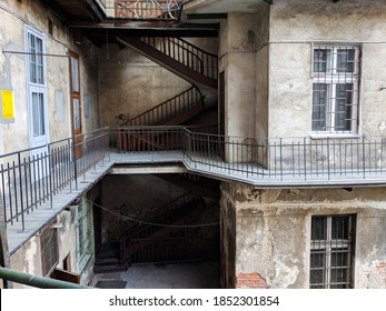 New York / USA - November 9 2020: Courtyard of an old, pre-war apartment building with falling plaster