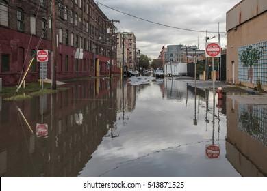 New York, USA - November Circa 2012: New York after Sandy the hurricane. Flooded street.
