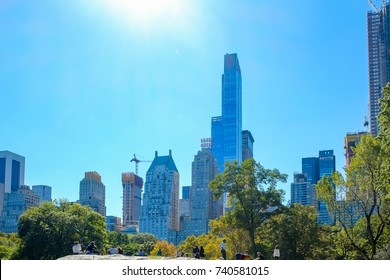 NEW YORK, USA - Oct 1, 2017: Sunny day in New York City Central Park with Manhattan skyline and skyscrapers