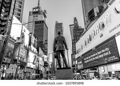 NEW YORK, USA  OCT 4, 2017:  neon advertising of News, brands and theaters at times square with statue of George m. Cohan in early morning. Times square is a symbol for New York life and amusement.