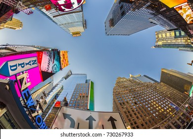 NEW YORK, USA - OCT 4, 2017:  neon advertising of News, brands and theaters at times square in late afternoon. Times square is a symbol for New York life and amusement.