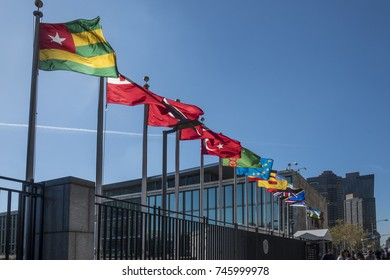 NEW YORK, USA - OCT 4, 2017:  UN Nations building with flags of participating countries in sun.