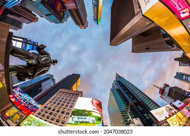 NEW YORK, USA  OCT 5, 2017:  neon advertising of News, brands and theaters at times square with statue of George m. Cohan in early morning. Times square is a symbol for New York life and amusement.
