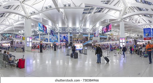 NEW YORK, USA - OCT 7, 2017:  people ready for check in at Terminal 4 in JFK airport, New York. In 1963 the airport was rededicated John F. Kennedy International Airport.