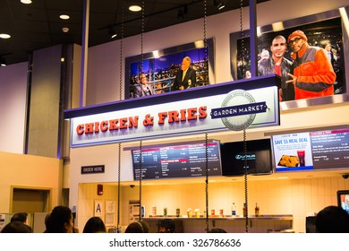 NEW YORK, USA - OCT 8, 2015: Chicken and fries at the Food court at the Madison Square Garden, New York City. MSG is the arena for basketball, ice hockey, pro wrestling, concerts and boxing.