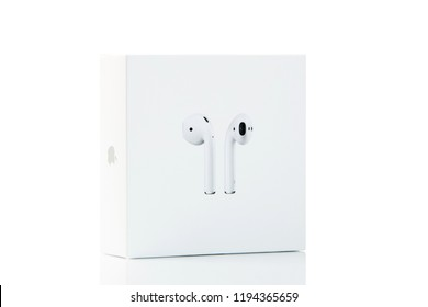 New York, USA - October 01, 2018: Apple airpods in white box isolated on white background. New apple earphones. Perspective view.