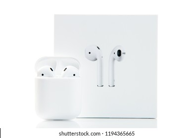 New York, USA - October 01, 2018: Apple earpods isolated on white background. New apple wireless earphones. Airpods in charger case. Wireless technologies. Electronics.