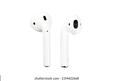 New York, USA - October 01, 2018: Apple airpods. Apple wireless earphones isolated on white background close-up. Wireless sound technology. Wireless electronics.