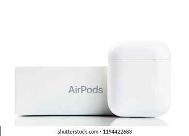 New York, USA - October 01, 2018: New modern apple wireless earphones in original package isolated on white background. Apple airpods with box. Wireless electronics. Technologies.