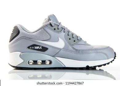 New York, USA - October 01, 2018: New grey Nike air max sneakers isolated on white background. Sport shoes.