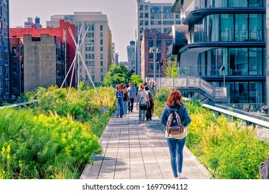 NEW YORK, USA - OCTOBER 01, 2018: The High Line a elevated linear park, greenway and rail trail created on a former New York Central Railroad spur in Manhattan. People walk the promenade.