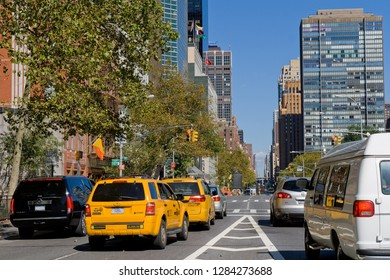 New York, USA - October 09, 2010: taxis and other cars on 1st Avenue on a bright sunny day with blue sky
