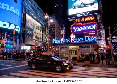 New York, USA - October 13, 2010: black car passes New York Police Department (NYPD) at Times Square at night