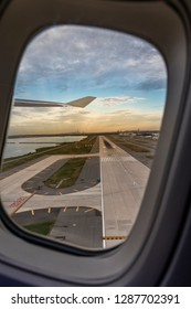 New York, New York / USA - October 14 2018: Take off from JFK Airport with New York in the background