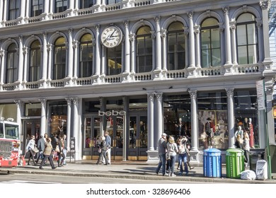 New York, New York, USA - October 15, 2015: The bebe store on Broadway in Soho Manhattan. bebe is a fashion retailer for women. People can be seen on the street.