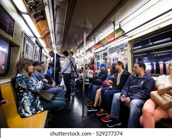 NEW YORK, USA - October 17, 2016. Inside New York City Subway Wagon with Other People in Background